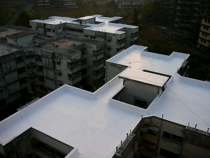 5 Reasons You Need a Roof Coating System for Your Commercial Building - Hawkeye Flat Roof Solutions